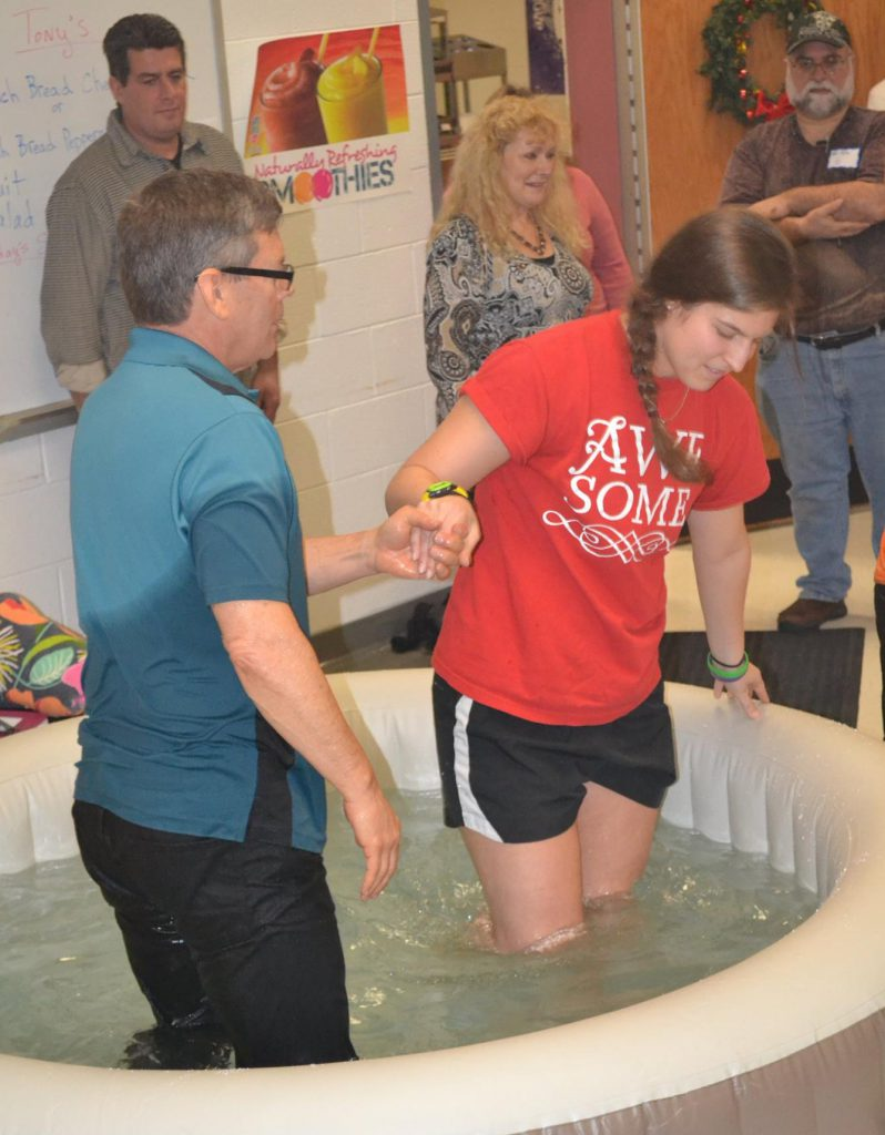 Pastor Scott baptizing Joan.